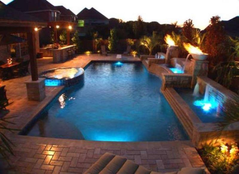 Beautiful swimming pool with beautiful lighting outdoor for Beautiful house designs with swimming pool