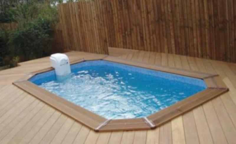 Sunsoka sport swimming pool with decking surround for Swimming pool surrounds design